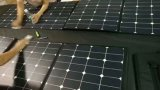 ISO 160W SunpowerのFoldable適用範囲が広く柔らかい伸縮性がある携帯用太陽携帯電話力パネルの充電器袋のパック