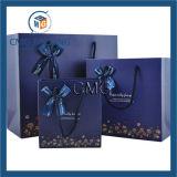 Saco de papel azul luxuoso com curva