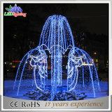 Weihnachtsgarten-blaues großes Brunnen-Licht