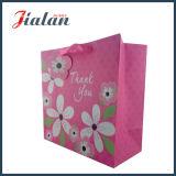 A cor da cor-de-rosa quente personaliza sacos de papel personalizados impressos para vestuários