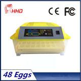 Ce bon marché complètement automatique de l'incubateur 12V+220V d'oeufs de qualité d'oeufs de Hhd 48 le mini a reconnu