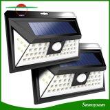 24 lumières solaires extérieures de détecteur de mouvement de DEL avec 3 DEL sur la lumière fixée au mur imperméable à l'eau sans fil de cornière large de détecteur de les deux côtés pour le patio, paquet, yard, jardin