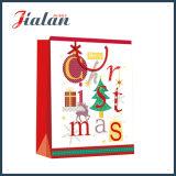 Sac de papier de achat estampé en gros de cadeau de transporteur de Joyeux Noël de promotion