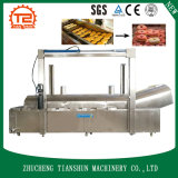Friteuse continue de beignet et beignet automatiques faisant frire la machine