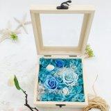 Disposizioni eterne all'ingrosso dei fiori conservati blu Rosa
