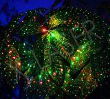 O festival Home Christmast da estrela efetua lasers ao ar livre do laser do verde vermelho