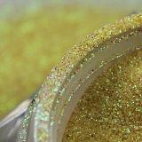 una polvere dorata di scintillio decorata con i chiodi