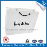 リボンのハンドルが付いている顧客用白いクラフト紙のショッピング・バッグ