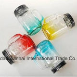 Bottiglia di vetro bevente colorata del vaso con il coperchio e la maniglia