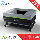 Машина лазера СО2 гравировки миниой ткани Jsx-1310 кожаный высекая
