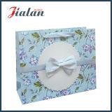 Fleurs de papier enes ivoire de qualité et sac de papier de cadeau d'achats de Bowknot