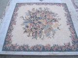 Mosaico em mármore no piso de malha