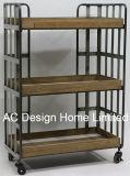 3つの層の旧式な型の装飾的な木または金属の棚のトロリー