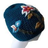 Beanie acrylique de vente chaud de bébé de 2017 de crochet de fleur subordonnés de chapeau