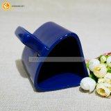 Tazza di caffè di ceramica a forma di creativa dell'azzurro reale di disegno