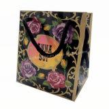 Do presente preto luxuoso feito sob encomenda do OEM da tomada da fábrica saco de papel com o punho de seda da fita para a mulher