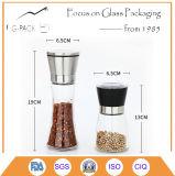 Vaso di vetro libero della spezia con la smerigliatrice dell'acciaio inossidabile