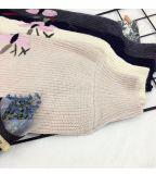 Cardigan di lavoro a maglia del ricamo