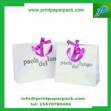 リボンのハンドルが付いている豪華なクラフト紙の買物袋のギフトの誕生会袋