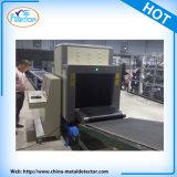 X光線のスキャンナーをスキャンする空港の保安の荷物および手荷物