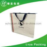 高さの品質のカスタムロゴによって印刷される衣類はハンドルが付いている包装のクラフト紙のショッピング・バッグを運ぶ