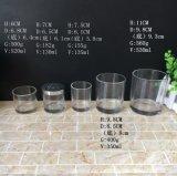 鋼鉄ふたが付いている円形シリンダーガラス蝋燭の瓶のガラスホールダー