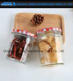 さまざまなサイズの食糧記憶のガラス蜂蜜は容器をピクルスにする