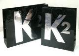 Sacchetti di carta del regalo di acquisto stampati bollo caldo per gli indumenti (FLP-8957)