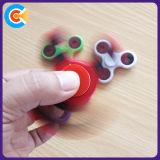Juguetes plásticos del hilandero de la persona agitada de la mano para la diversión
