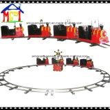 Train de parc d'attractions avec le chemin de fer et la frontière de sécurité d'acier inoxydable