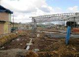 Almacén/hangar modificados para requisitos particulares de la estructura del marco de acero del diseño