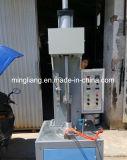 Machine pneumatique semi-automatique de plateau du gâteau DGT-P1
