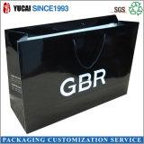 Saco de empacotamento da roupa de prata do saco de compra do papel do preto do logotipo