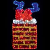 Le motif de DEL allume Santa coincée dans les décorations extérieures de Noël de lumière de cheminée