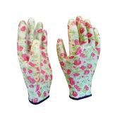 Le volume enduit de gants d'impression de jardin de nitriles de dames
