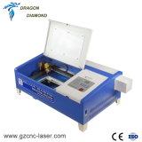 Mini 50W de corte láser de CO2 Máquina de grabado de vidrio acrílico/ /Madera