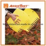 La mano ajustable rastrilla las cucharadas de la hoja del jardín y de la yarda