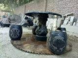 Il granito nero che intaglia la tavola rotonda con quattro banchi rotondi per la casa &Garden la decorazione