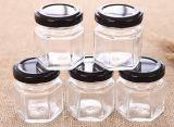 Vaso di vetro di memoria del miele di esagono con il coperchio del metallo dello stagno