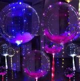 La stringa del LED illumina l'aerostato trasparente per la decorazione della festa di Natale di cerimonia nuziale