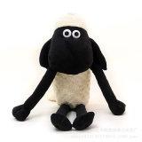 Jouet en peluche aux agneaux