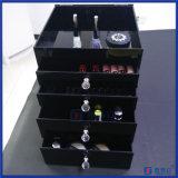 Cinque strati dell'organizzatore cosmetico nero acrilico con quattro cassetti