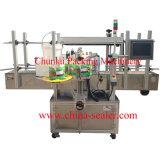 윤활유 물통 레테르를 붙이는 기계