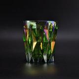 虹色の緑ガラス蝋燭の瓶