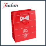 La coutume bon marché vend le sac de papier de empaquetage estampé par logo de cadeau