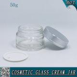 Transparentes Glasgesichtssahneglas mit silberner Mattschutzkappe 50ml