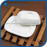 Piatto di burro di ceramica dell'osso con il coperchio