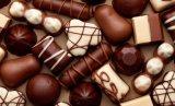 Dos pistas terminan a depositante del chocolate de la producción