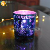 Sostenedor de vela de cristal coloreado de la Navidad