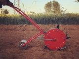 手動種取り機のトウモロコシの大豆の種まき肥料プランター